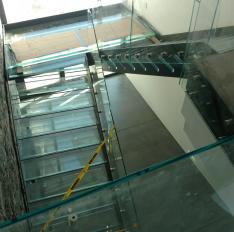 Glass Unlimited Glass railing with glass treads and glass flooring