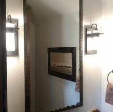 Glass Unlimited Custom mirror with hammered iron frame.