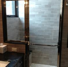 Glass Unlimited Solid brass nickel plated framed shower enclosure with divided lights.