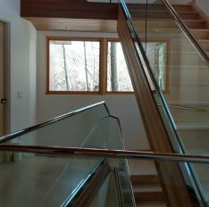 Glass Unlimited polished stainless grab rails with star fire glass.