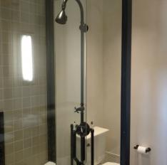 Glass Unlimited Solid brass framed Tub Enclosure oil rubbed bronze finish.