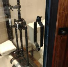 Glass Unlimited Solid brass framed Tub Enclosure with custom handle.